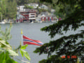 Flag and Norwegian boathouses